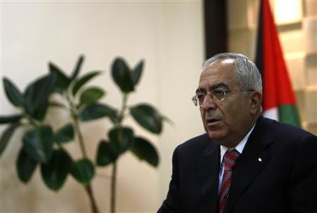 Palestinian Prime Minister Salam Fayyad speaks during an interview with Reuters in the West Bank city of Ramallah June 10, 2010. REUTERS/Mohamad Torokman