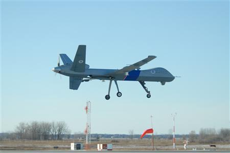 The U.S. Customs and Border Protection's first MQ-9 Predator B unmanned aerial vehicle to be stationed along the northern border of the United States lands at Grand Forks Air Force Base, N.D., Dec. 6, 2008. REUTERS/Department of Defense/Senior Master Sgt. David H. Lipp/Handout