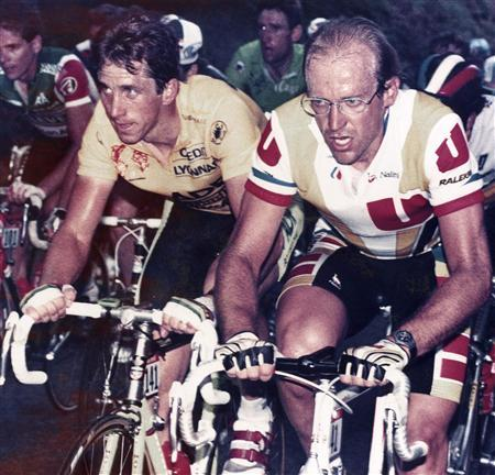 Laurent Fignon of France (R) and Greg LeMond of the U.S. ride side by side during the 9th stage of the Tour de France cycling race between Pau and Cauterets in this July 10, 1989 file picture. REUTERS/Eric Gaillard/Files