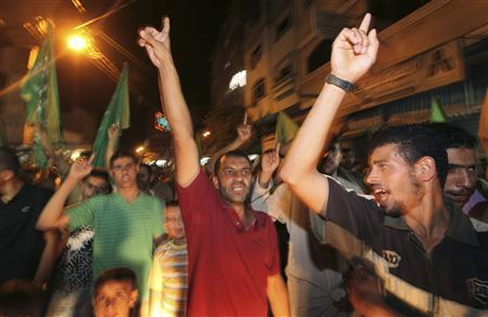 Hamas supporters celebrate the shooting attack in the West Bank, in Jabalya refugee camp in the northern Gaza Strip, August 31, 2010. REUTERS/Mohammed Salem
