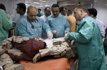Medical staff treat a wounded soldier after a bomb attack in Baghdad September 5, 2010. Suicide bombers and gunmen tried to storm an army base in Baghdad on Sunday, killing at least seven people and wounding 22 less than a week after Washington declared U.S. combat operations in Iraq over, officials said. REUTERS/Stringer