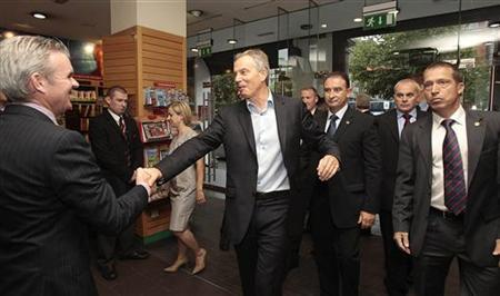 Former British Prime Minister Tony Blair (4th L) is greeted by Conor Whelen (L), Managing Director of Eason book store in Dublin, Ireland September 4, 2010. REUTERS/Niall Carson/Pool
