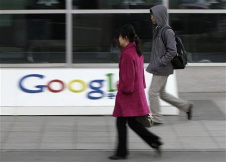 People walk towards the Google China headquarters in Beijing March 23, 2010. REUTERS/Jason Lee