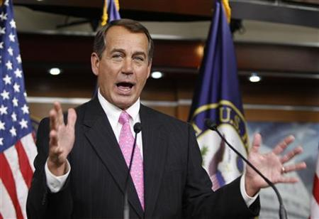 U.S. House Minority Leader Rep. John Boehner (R-OH) gestures as he addresses his weekly news conference with Capitol Hill reporters in Washington, March 19, 2010. REUTERS/Hyungwon Kang