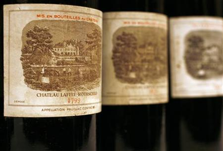Bottles from a lot of 70 ''Four Centuries of Chateau Lafite Rothschild'' bottles, which includes bottles between 1799 and 2003, are displayed during a news conference in Hong Kong March 24, 2010. REUTERS/Bobby Yip