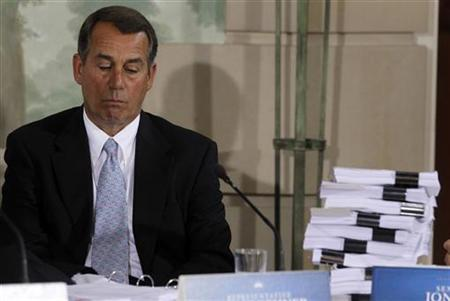 U.S. House Minority Leader John Boehner (R-OH) is pictured alongside a stack of proposed health reform legislation during a bipartisan meeting at Blair House in Washington, February 25, 2010. REUTERS/Jason Reed