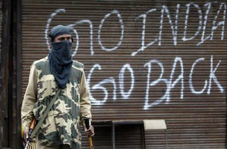 A policeman stands guard near a closed shop during a curfew in Srinagar September 14, 2010. REUTERS/Danish Ismail