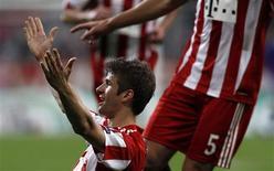 <p>Thomas Mueller, do Bayern Munich, comemora gol em vitória por 2 x 0 sobre a Roma. REUTERS/Michaela Rehle</p>