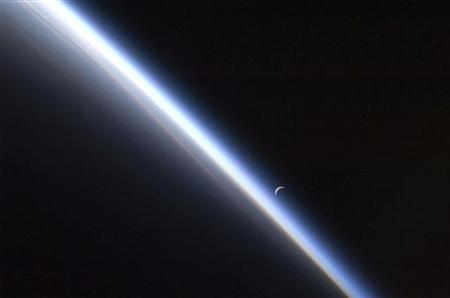 A setting last quarter crescent moon and the thin line of Earth's atmosphere are photographed by an Expedition 24 crew member as the International Space Station passes over central Asia September 4, 2010 in this NASA handout photo obtained September 10, 2010. Picture taken September 4, 2010. REUTERS/NASA/Handout THIS IMAGE HAS BEEN SUPPLIED BY A THIRD PARTY. IT IS DISTRIBUTED, EXACTLY AS RECEIVED BY REUTERS, AS A SERVICE TO CLIENTS. FOR EDITORIAL USE ONLY. NOT FOR SALE FOR MARKETING OR ADVERTISING CAMPAIGNS