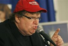 <p>Filmmaker Michael Moore speaks at a news conference in Washington September 29, 2009. REUTERS/Molly Riley</p>