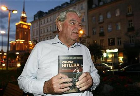 David Irving, the British Holocaust-denier, holds his book titled ''It happened in the XX century Hitler's War'' as he speaks to Reuters during an interview in Warsaw September 21, 2010. Irving has begun a controversial visit to Poland for a tour of World War II sites and places where Jews were persecuted. REUTERS/Kacper Pempel
