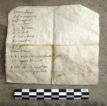 A letter discovered in northern Peru in 2008 showing a column of numbers written in Spanish and translated into a language that scholars say is now extinct, is seen in this undated photo released by archaeologists September 22, 2010. REUTERS/Handout