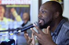 <p>Haitian singer Wyclef Jean, a candidate for the next presidential election in Haiti, attends a news conference before his concert at the Antilliaanse Feesten music festival in Hoogstraten, August 13, 2010. REUTERS/Sebastien Pirlet</p>