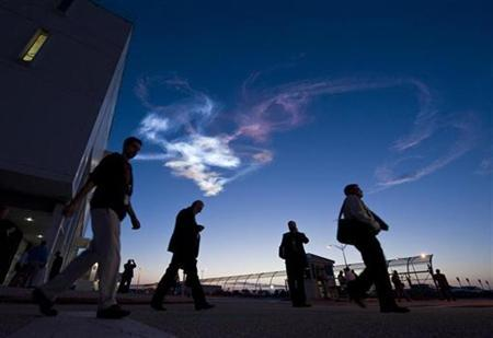 Contrails are seen as workers leave the Launch Control Center after the launch of the space shuttle Discovery and the start of the STS-131 mission at NASA Kennedy Space Center in Cape Canaveral, Florida, April 5, 2010. REUTERS/Bill Ingalls-NASA/Handout