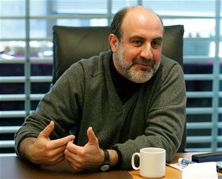 Nassim Taleb speaks to reporters at the Reuters Finance Summit in New York November 16, 2005.