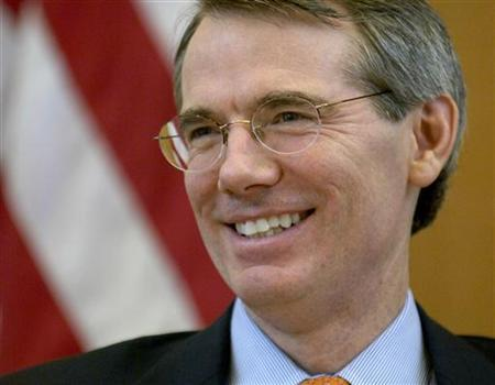 Former U.S. Trade Representative Rob Portman smiles during a news conference at the U.S. embassy in Geneva July, 29, 2005. REUTERS/Denis Balibouse