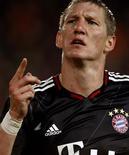 <p>Bastian Schweinsteiger, do Bayern Munich, comemora segundo gol na vitória por 2 x 1 sobre o FC Basel pela Liga dos Campeões. REUTERS/Arnd Wiegmann</p>