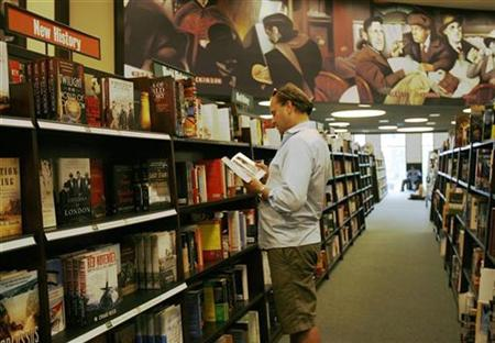 A patron browses through a book at the Barnes and Noble bookstore on the corner of Warren and Greenwich street in New York June 29, 2010. REUTERS/Lily Bowers