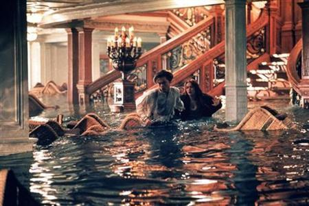 Leonardo DiCaprio and Kate Winslet react in a scene as flooding takes place in the first class reception area in ''Titanic,''. REUTERS/Handout