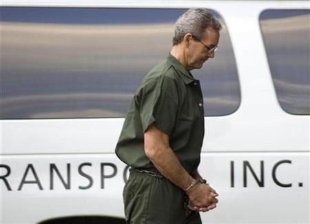 Allen Stanford, the former billionaire accused of a $7 billion fraud, arrives at federal court in Houston wearing handcuffs and leg irons October 14, 2009. REUTERS/Richard Carson