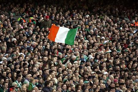 An Irish fan waves his national flag during a Six Nations championship rugby union match against France at Dublin's Croke Park stadium February 11, 2007. REUTERS/Charles Platiau