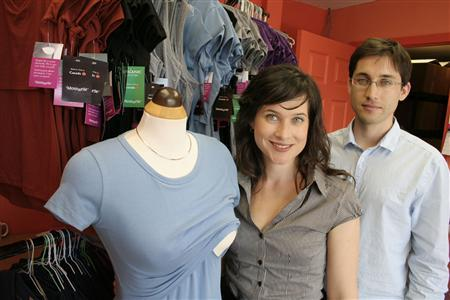 Momzelle co-founders Christine Poirier and her brother Vincent at their office in Toronto. Picture taken June 2010. REUTERS/Jillian Kitchener
