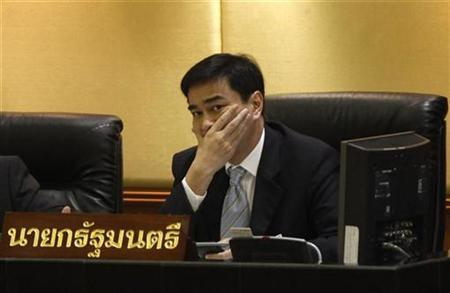 Thailand's Prime Minister Abhisit Vejjajiva attends a parliamentary session in Bangkok, August 19, 2010. REUTERS/Chaiwat Subprasom
