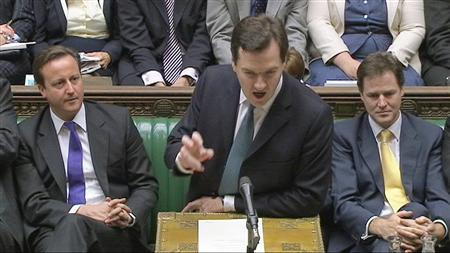 A still image from video shows Britain's Finance Minister George Osborne, flanked by Prime Minister David Cameron and Deputy Prime Minister Nick Clegg, announcing the UK government's spending plans at parliament in London, October 20, 2010. REUTERS/Parbul TV via Reuters TV