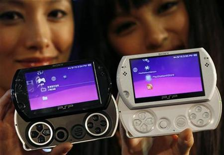 Models display the new Sony PSPGo during a news conference in Hong Kong September 16, 2009 ahead of its world-wide launch. REUTERS/Bobby Yip