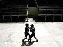 <p>Two eleven-year-old Cuban boys face each other during their boxing training at an Old Havana neighbourhood boxing gym, August 12, 2003.REUTERS/Claudia Daut</p>