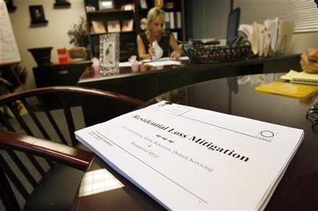A packet sent out to home owners in default of mortgage payments sits on the table of Margery Rotundo, senior Vice President of Residential Loss Mitigation at national subprime loan servicer Ocwen Financial Corporation, in West Palm Beach September 10, 2009. REUTERS/Hans Deryk