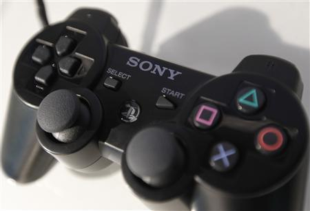 Sony Corp's logo is seen on its PlayStation controller at its showroom in Tokyo, October 26, 2010. REUTERS/Kim Kyung-Hoon