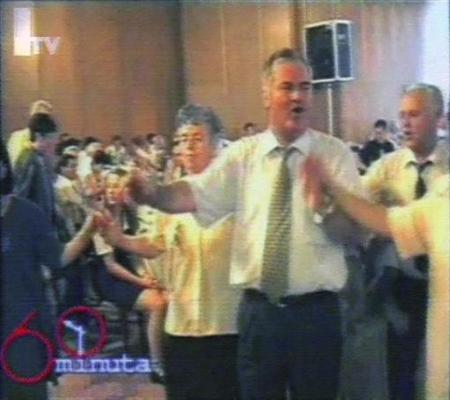 An image taken from Bosnian television footage on June 11, 2009 shows Bosnian Serb war crimes fugitive Ratko Mladic (2nd R) dancing with friends and family members at his son's wedding party. REUTERS/Bosnia Federation TV via Reuters TV