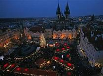 <p>A Christmas tree is illuminated as the traditional Christmas market opens at the Old Town Square in Prague November 29, 2009. REUTERS/David W Cerny</p>