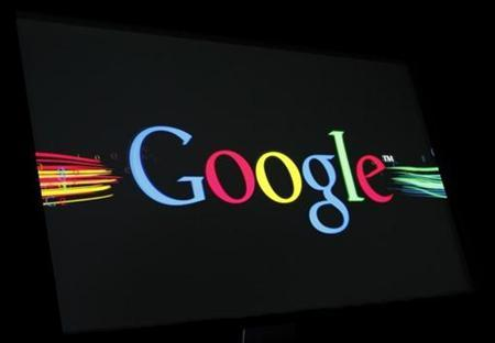 The Google Inc logo is projected on a screen during the unveiling of ''Google Instant'' at a news conference in San Francisco, California in this September 8, 2010 file photo. REUTERS/Robert Galbraith