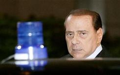 <p>Italy's Prime Minister Silvio Berlusconi leaves a two-day Summit of the European Union Heads of States and Governments, in Brussels October 29, 2010. REUTERS/Sebastien Pirlet</p>
