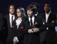 <p>Children of Michael Jackson, Prince Michael Jackson (2nd R) and Paris Jackson (2nd L), accept an honorary Grammy at the 52nd annual Grammy Awards in Los Angeles January 31, 2010. REUTERS/Mike Blake</p>
