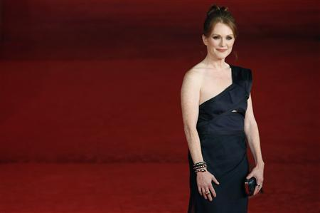 Actress Julianne Moore arrives on the red carpet to attend the screening of her film 'The kids are all right' at the Rome Film Festival, November 2, 2010. REUTERS/Alessia Pierdomenico