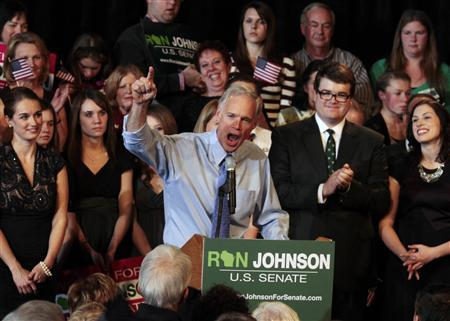 Winning Senate Republican candidate Ron Johnson delivers a speech to supporters during an election night party at the Experimental Aircraft Association Museum at Wittman Field in Oshkosh, Wisconsin, November 2, 2010. REUTERS/Allen Fredrickson