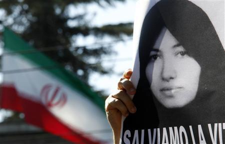 A demonstrator holds a picture of Sakineh Mohammadi Ashtiani, in front of the Iranian Embassy in Rome in this September 2, 2010 file photo. REUTERS/Stefano Rellandini/Files