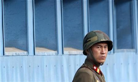 A North Korean soldier looks south as he stands guard upon Asia-Pacific military leaders' visit to the south side of truce village of Panmunjom in the demilitarized zone separating the two Koreas in Paju, north of Seoul, October 20, 2010. REUTERS/Jo Yong-Hak