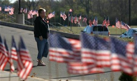 A voter leaves her polling station during midterm elections, in Mason, Ohio November 2, 2010. REUTERS/Matt Sullivan
