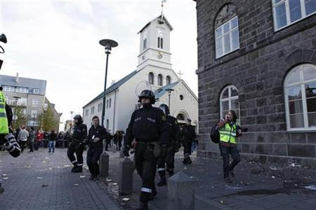 Police officers patrol the area around Iceland's parliament (R) during a protest in Reykjavik October 1, 2010. Reuters/Ingolfur Juliusson