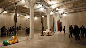 <p>People look at sculptures by U.S. artist John Baldessari during a show at the Prada Foundation in Milan October 28, 2010. REUTERS/Stefano Rellandini</p>