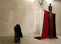 <p>People look at a sculpture by U.S. artist John Baldessari during a show at the Prada Foundation in Milan October 28, 2010. REUTERS/Stefano Rellandini</p>