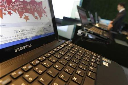 A business man uses a laptop displayed at main office of Samsung Electronics in Seoul October 7, 2010. REUTERS/Lee Jae-Won