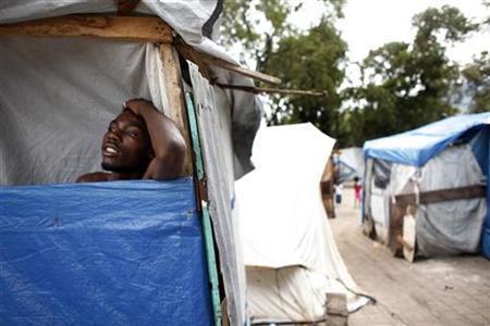 A resident waits inside his tent as Tropical Storm Tomas arrives at Port-au-Prince, November 4, 2010. REUTERS/ Eduardo Munoz