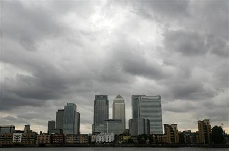 Storm clouds are seen above the Canary Wharf financial district in this August 3, 2010 file photo. REUTERS/Greg Bos