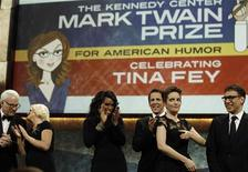 <p>Comedian Tina Fey (2nd R) reacts after receiving the 12th annual Mark Twain Prize for American Humor hosted by The Kennedy Center in Washington, November 9, 2010. REUTERS/Larry Downing</p>