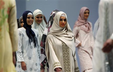 Models present creations for Muslim women during an Islamic Fashion Fair in Istanbul April 11, 2010. REUTERS/Murad Sezer